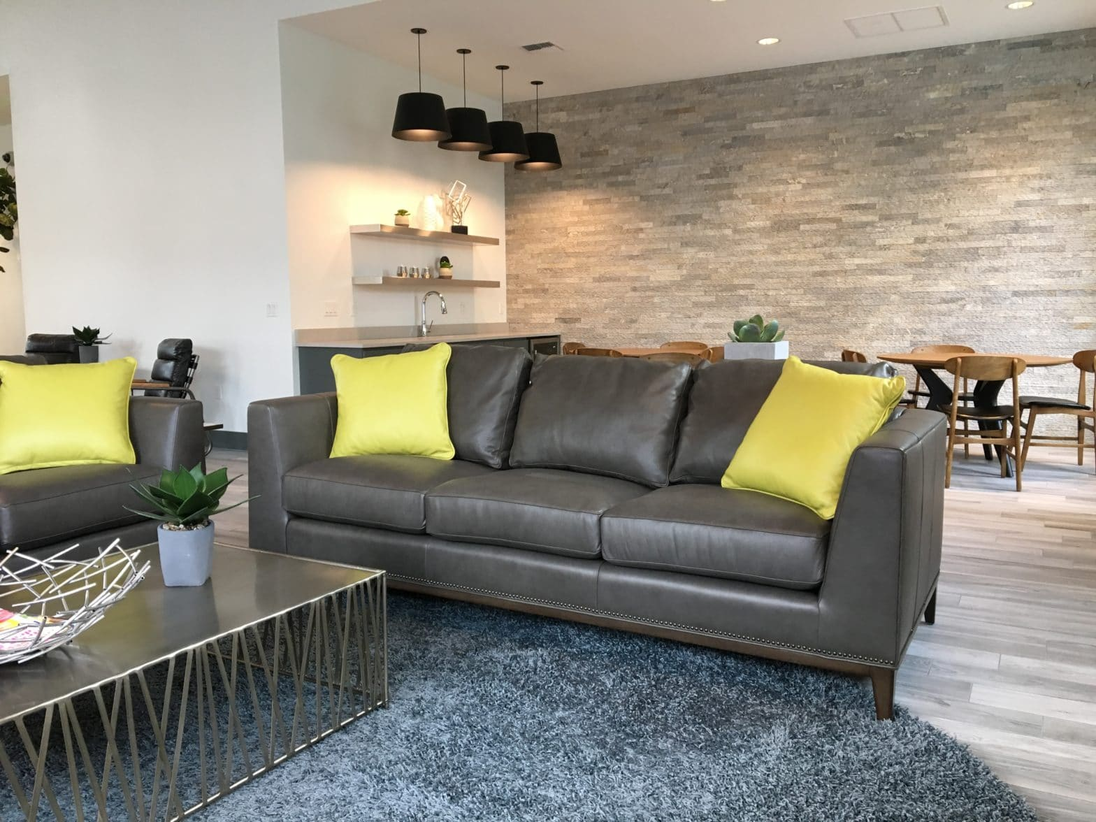 modern style sofa with chartreuse throw pillows