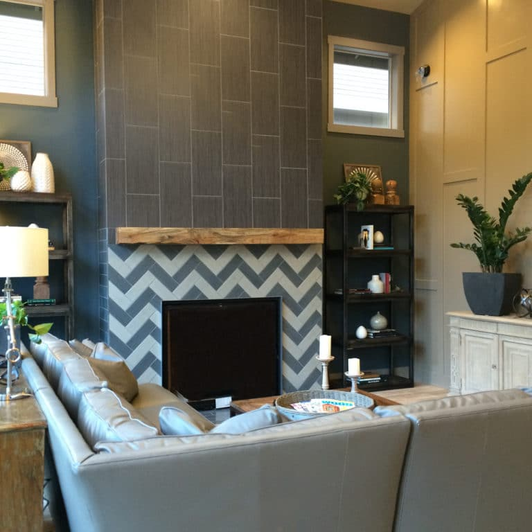 Transitional Design Living Room With Chevron-tiled Fireplace