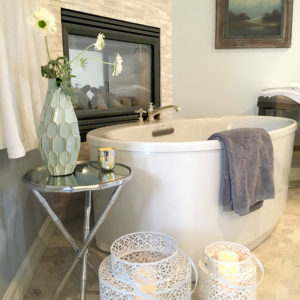 transitional style bathroom design with freestanding tub and plants
