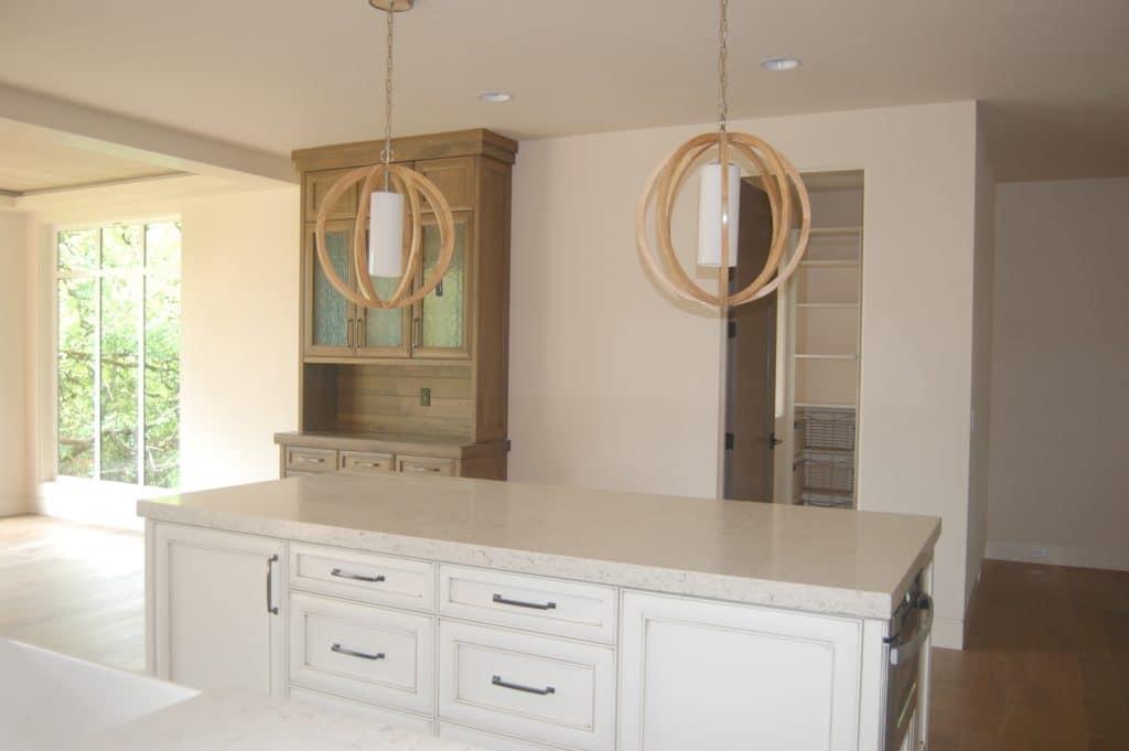 custom kitchen design with wood light fixtures