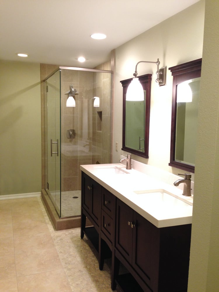 After photo of bathroom remodel with double vanity sinks