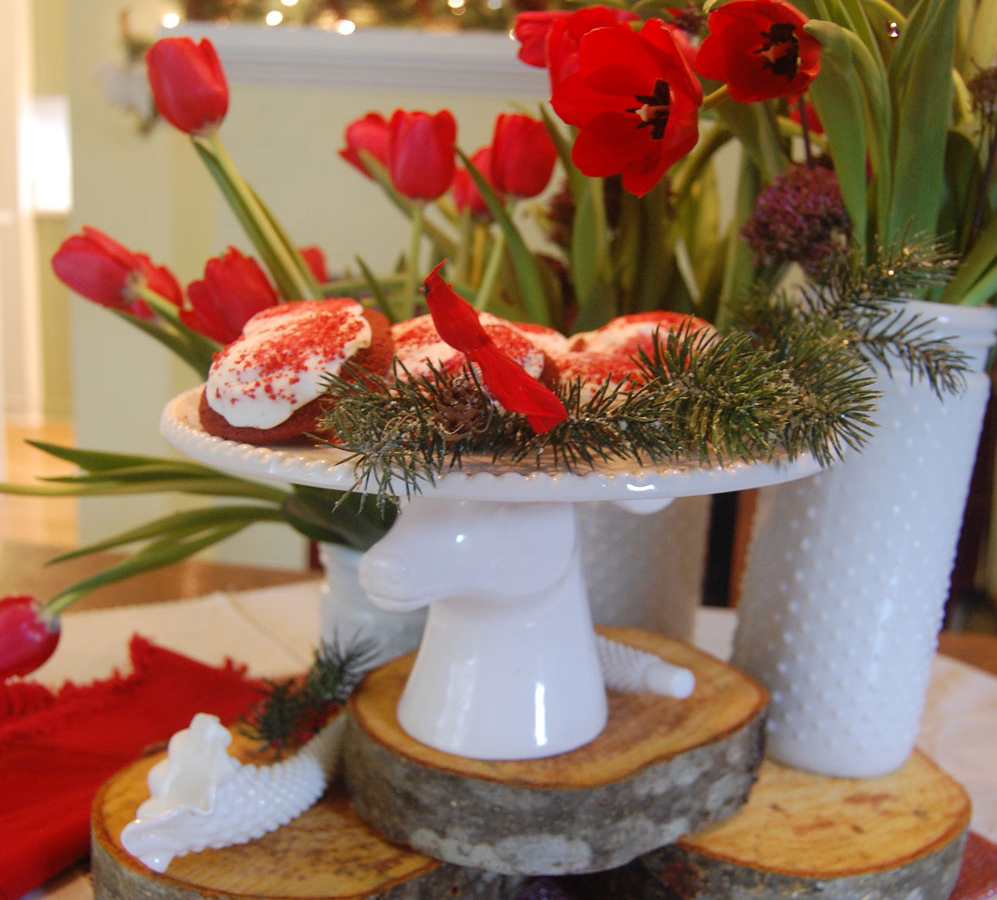 Adorable Christmas Cookie Table Arrangement With Glass Animals and Red Flowers