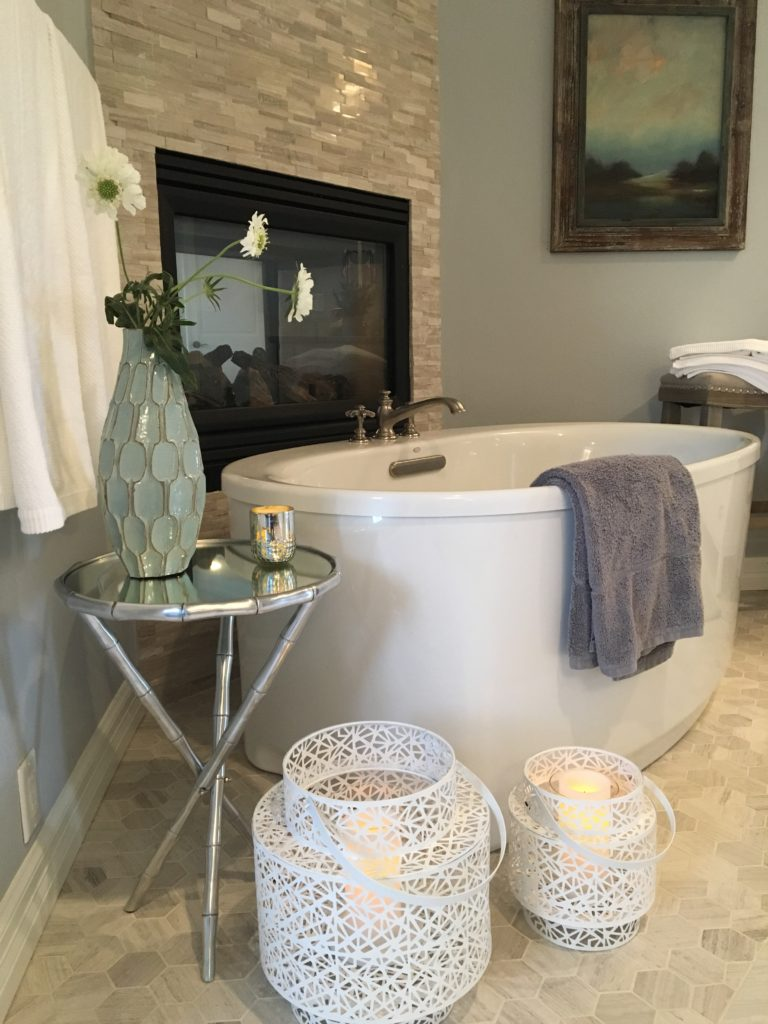 contemporary bathroom with freestanding tub and plants