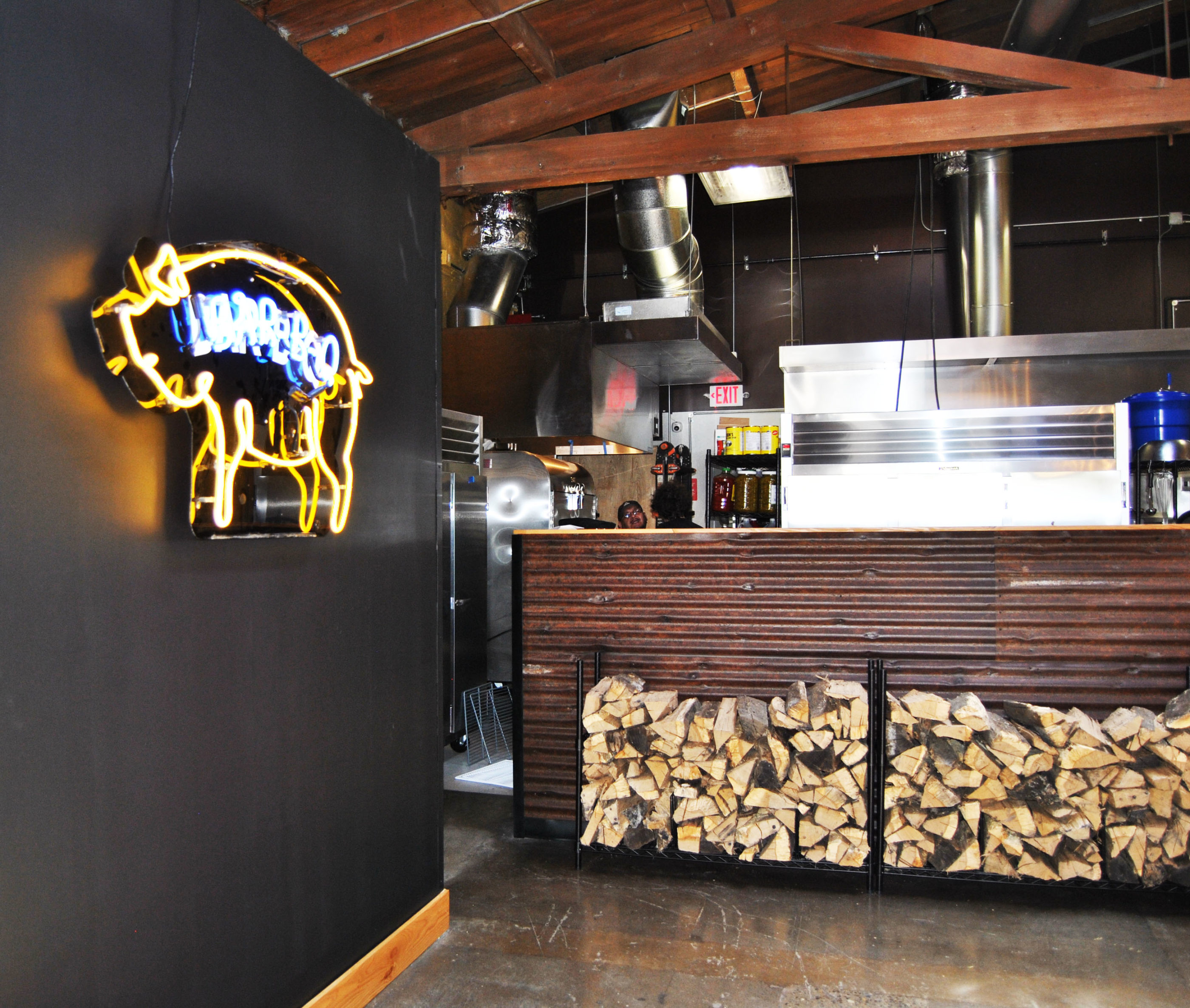 russell st bbq restaurant design neon pig on black wall