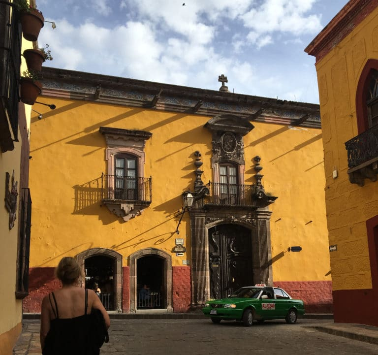 San Miguel architecture with yellow and red paint