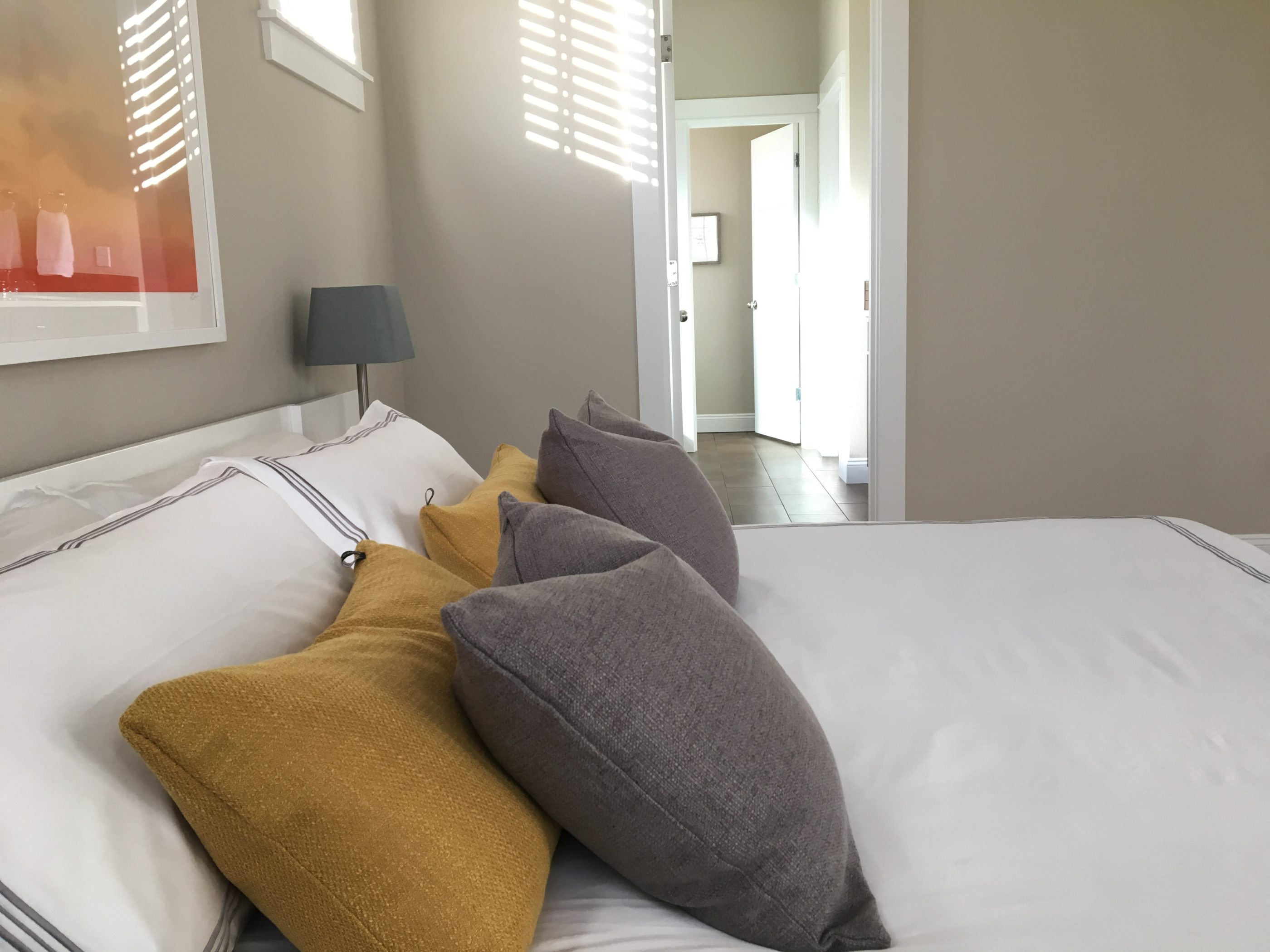 mASTER bedroom design with yellow and gray pillows