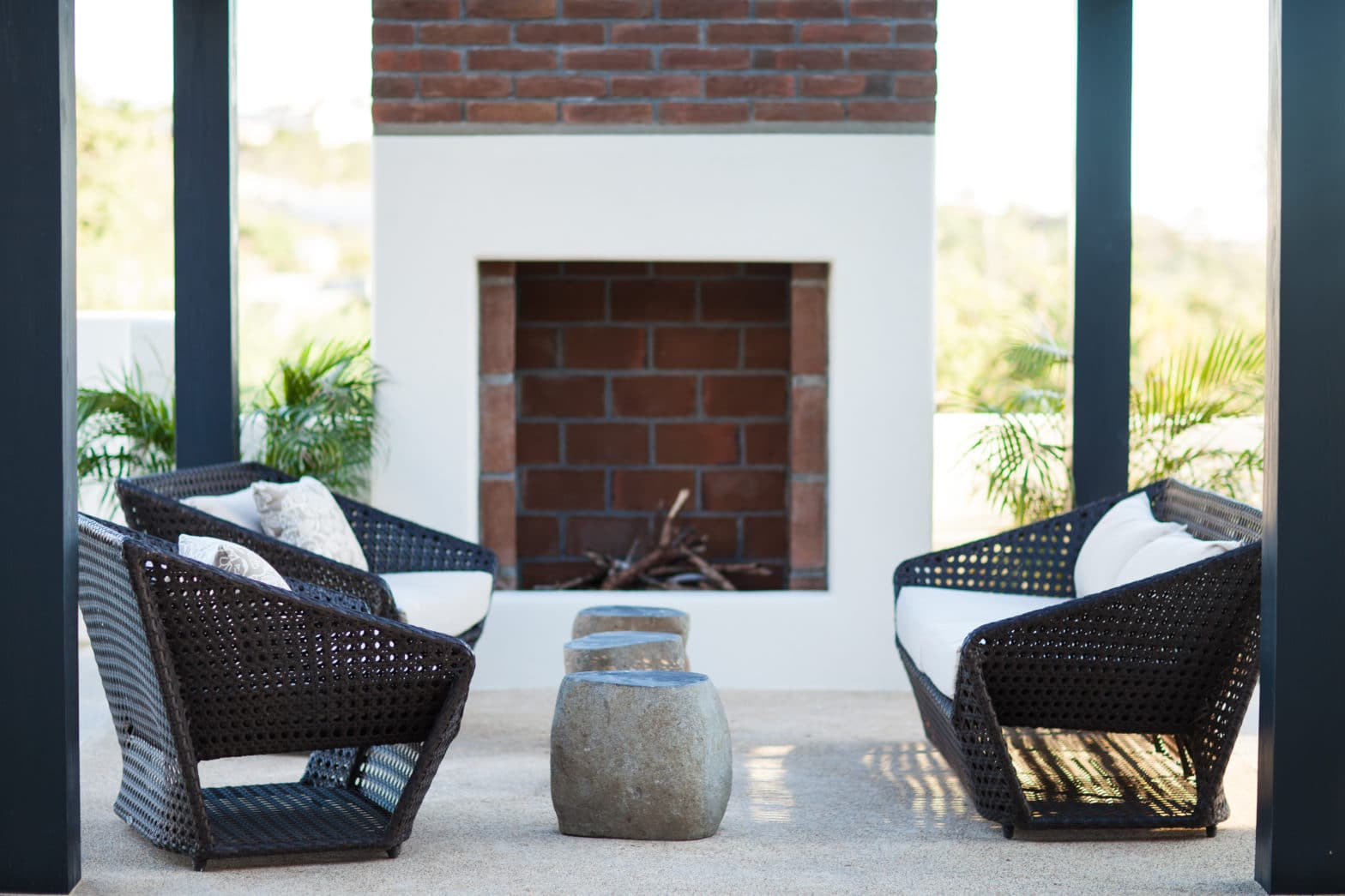 Luxurious Outdoor Furniture by poolside fireplace