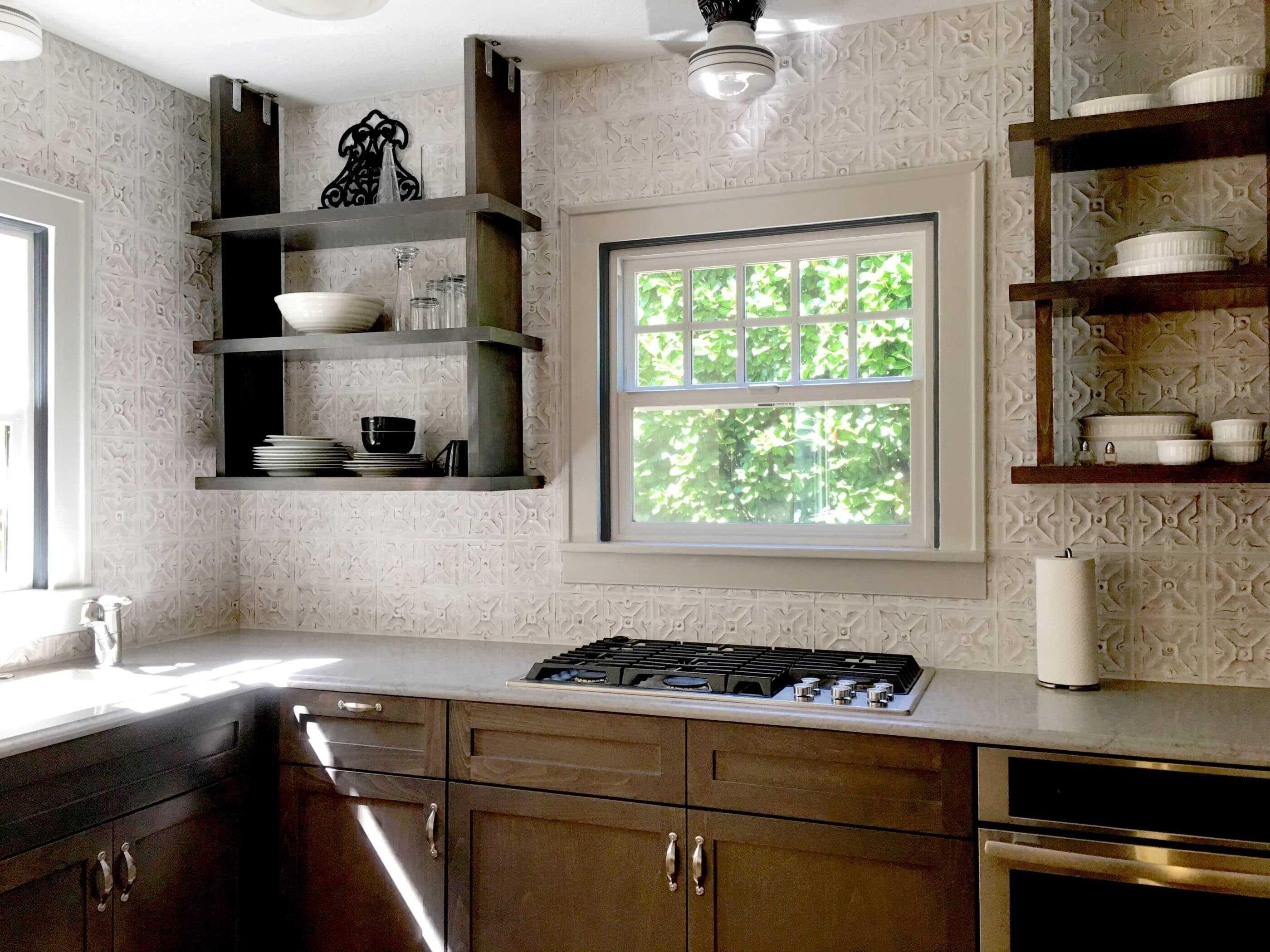 beautiful kitchen remodel with gray tile backsplash