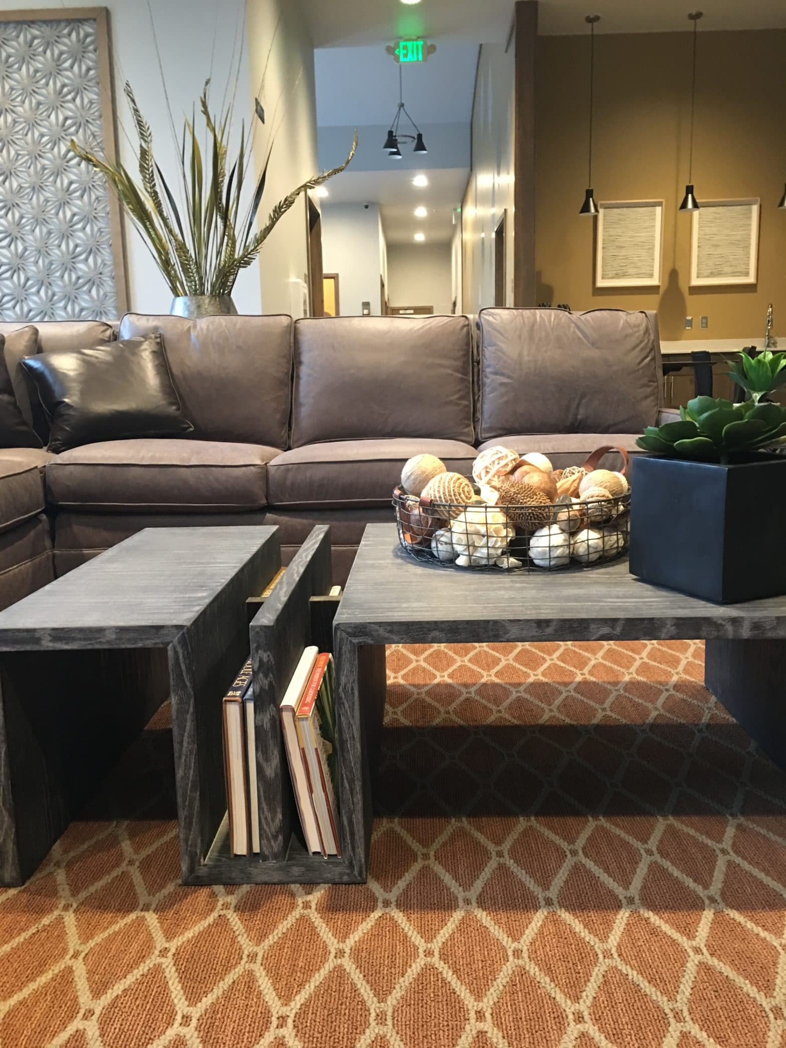 area rug in fall color season orange with gray coffee table