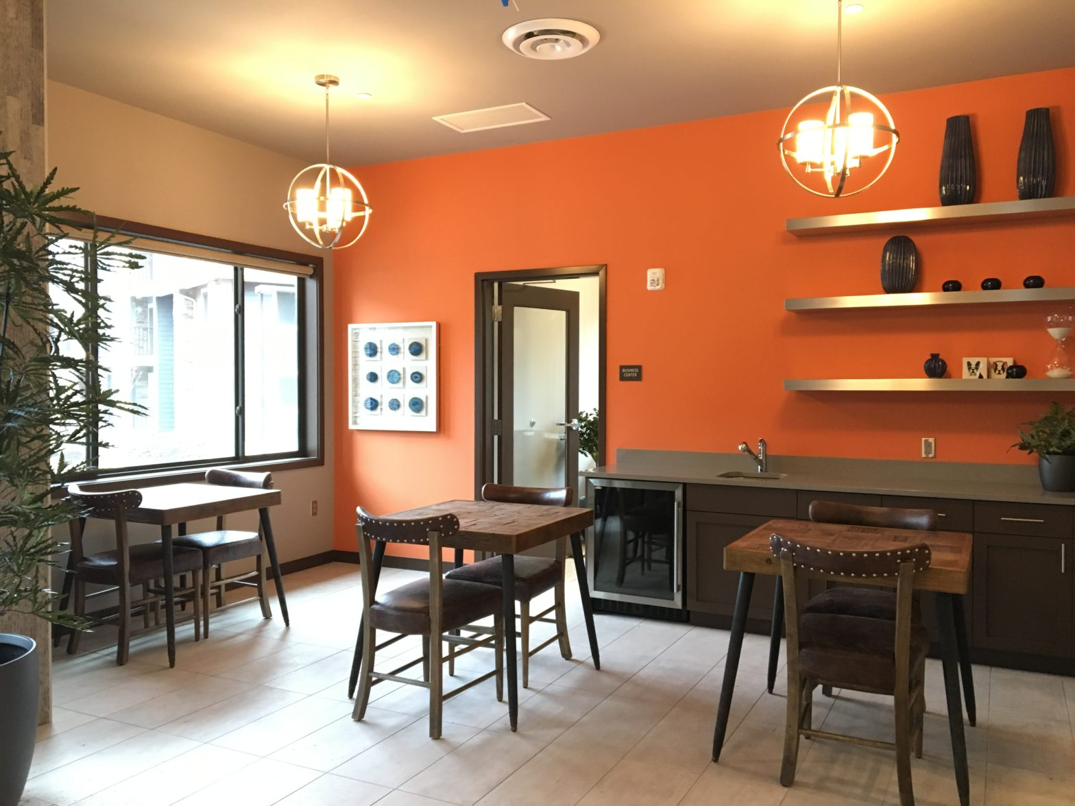 Common Area In Apartment Building With Orange Wall