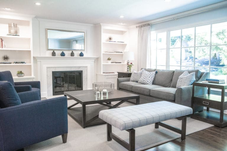 Contemporary Living Room Remodel with White Shelves and Grey Custom Sofas