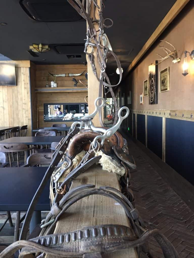 western decor leather saddles on ledge