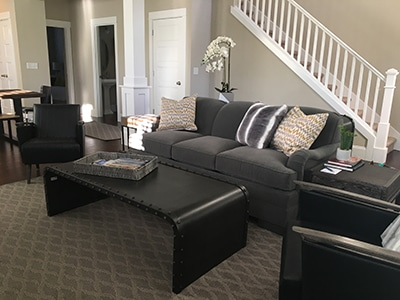 custom sofa in gray fabric with black coffee table
