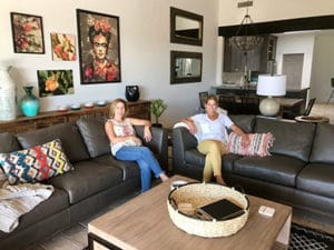 Allison and client on custom sofa in vacation home