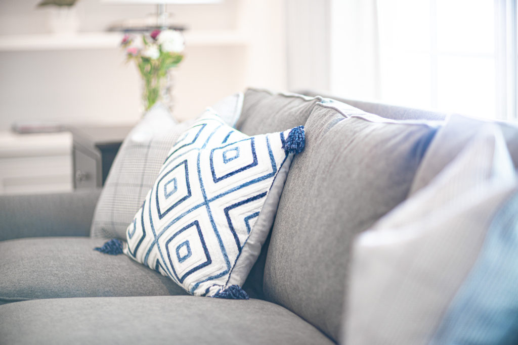 Grey Sofa With Blue Patterned Pillow
