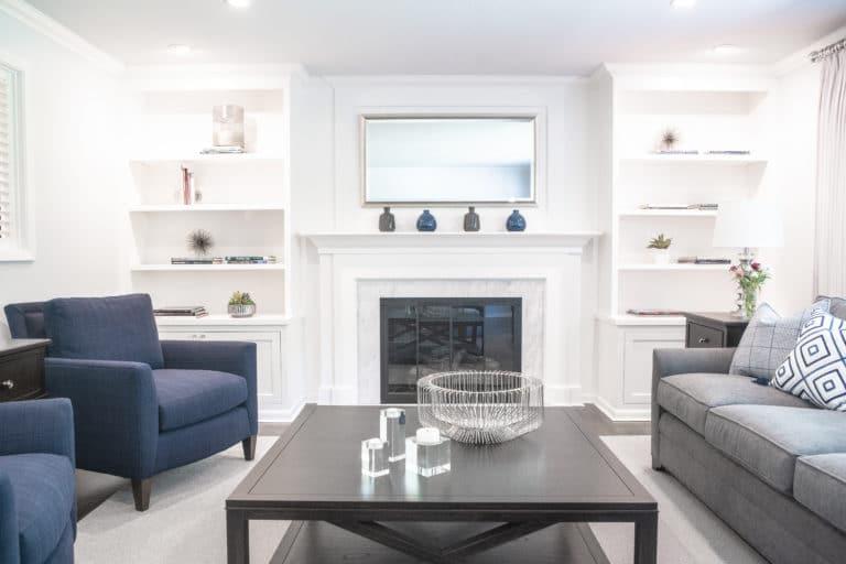 Monochromatic Modern Living Room Design With White Shelving