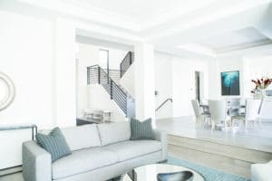 full home remodel with white walls and black railing