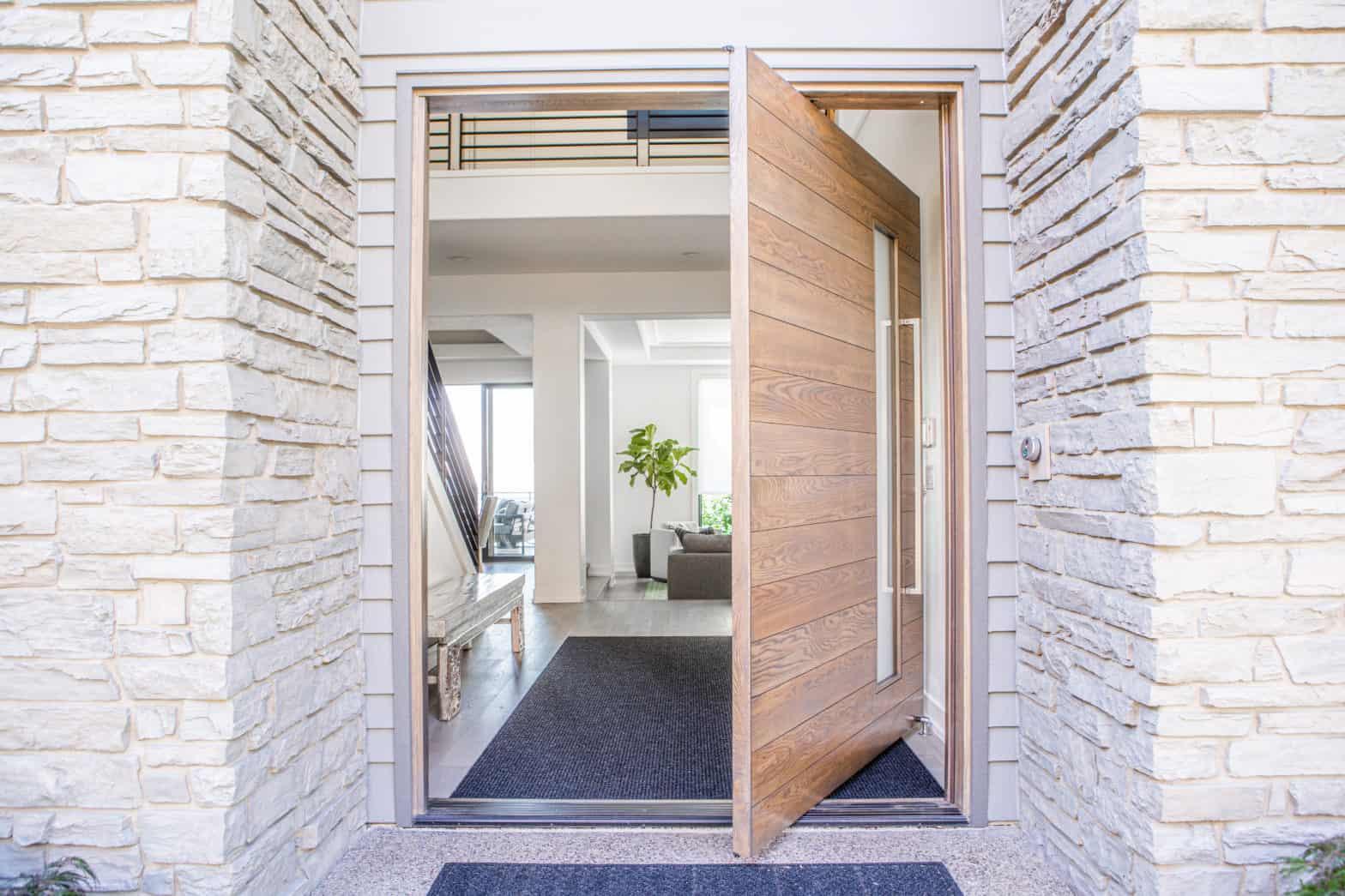 modern home with custom pivot door design