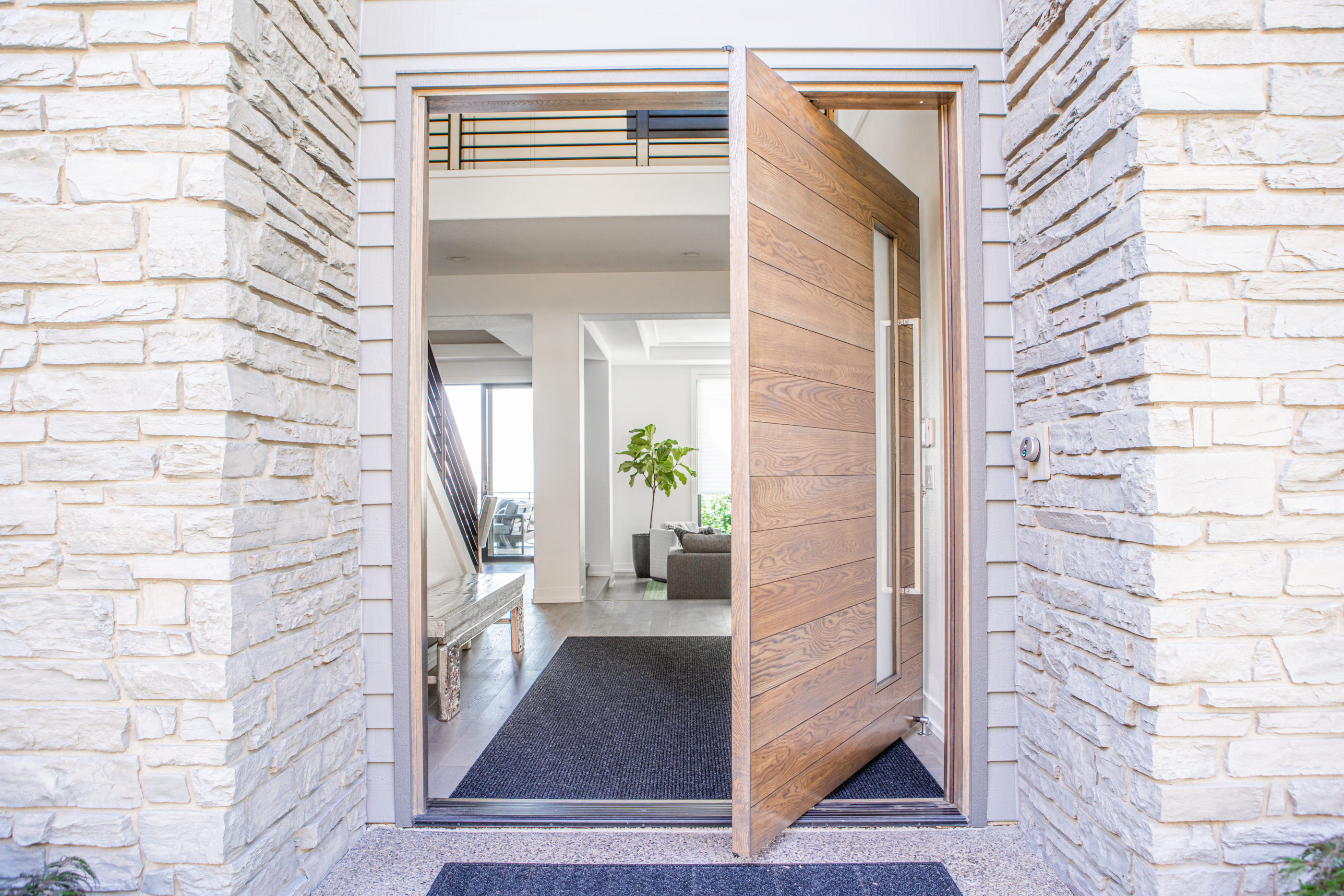 modern home with custom pivot door design