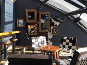 mirror wall interior design with cow hide chairs
