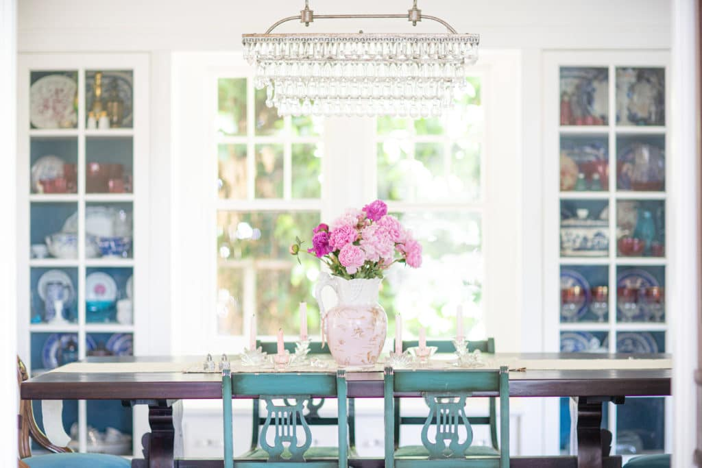 dining table with turquoise chairs and floral design