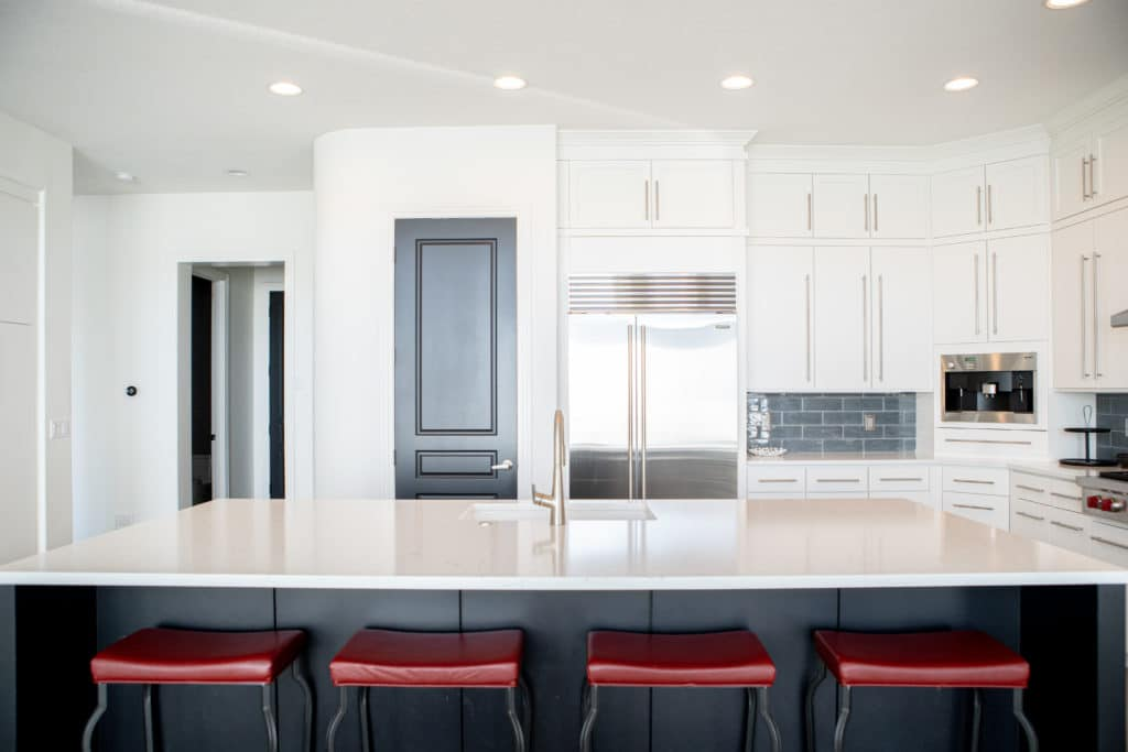 modern kitchen interior with red stools