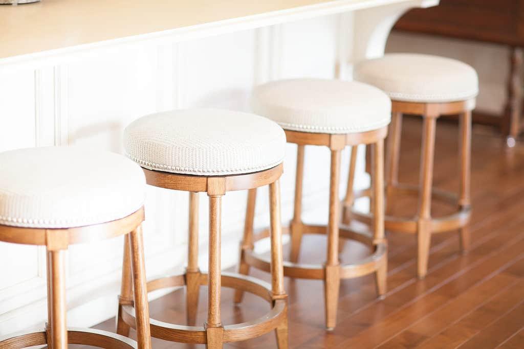 custom traditional bar stools with cream fabric