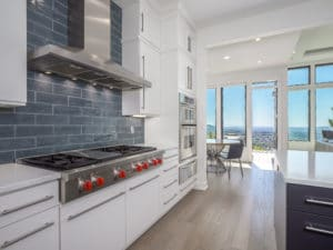 modern kitchen interior with white cabinets and stainless steel appliances