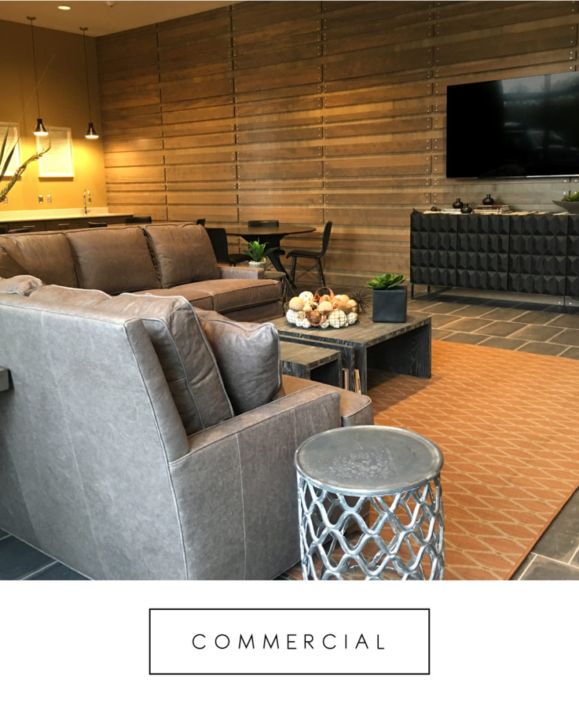 commercial project interior with orange area rug gray sofa