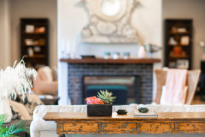 ecelectic accents in front of stone fireplace