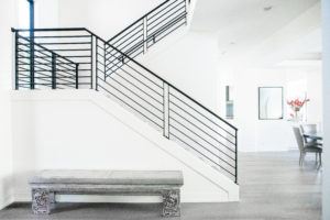 modern staircase remodel with black railing