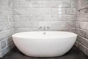 freestanding tub in luxury bathroom remodel