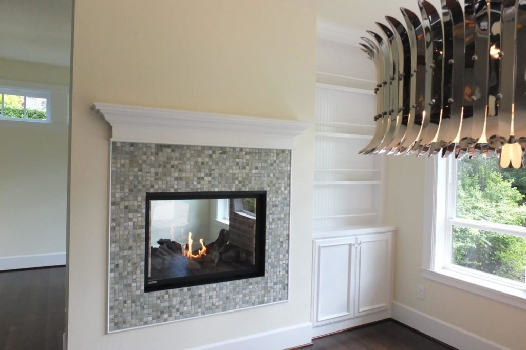 Dining Room with Tiled Fireplace and White Built-In Casework
