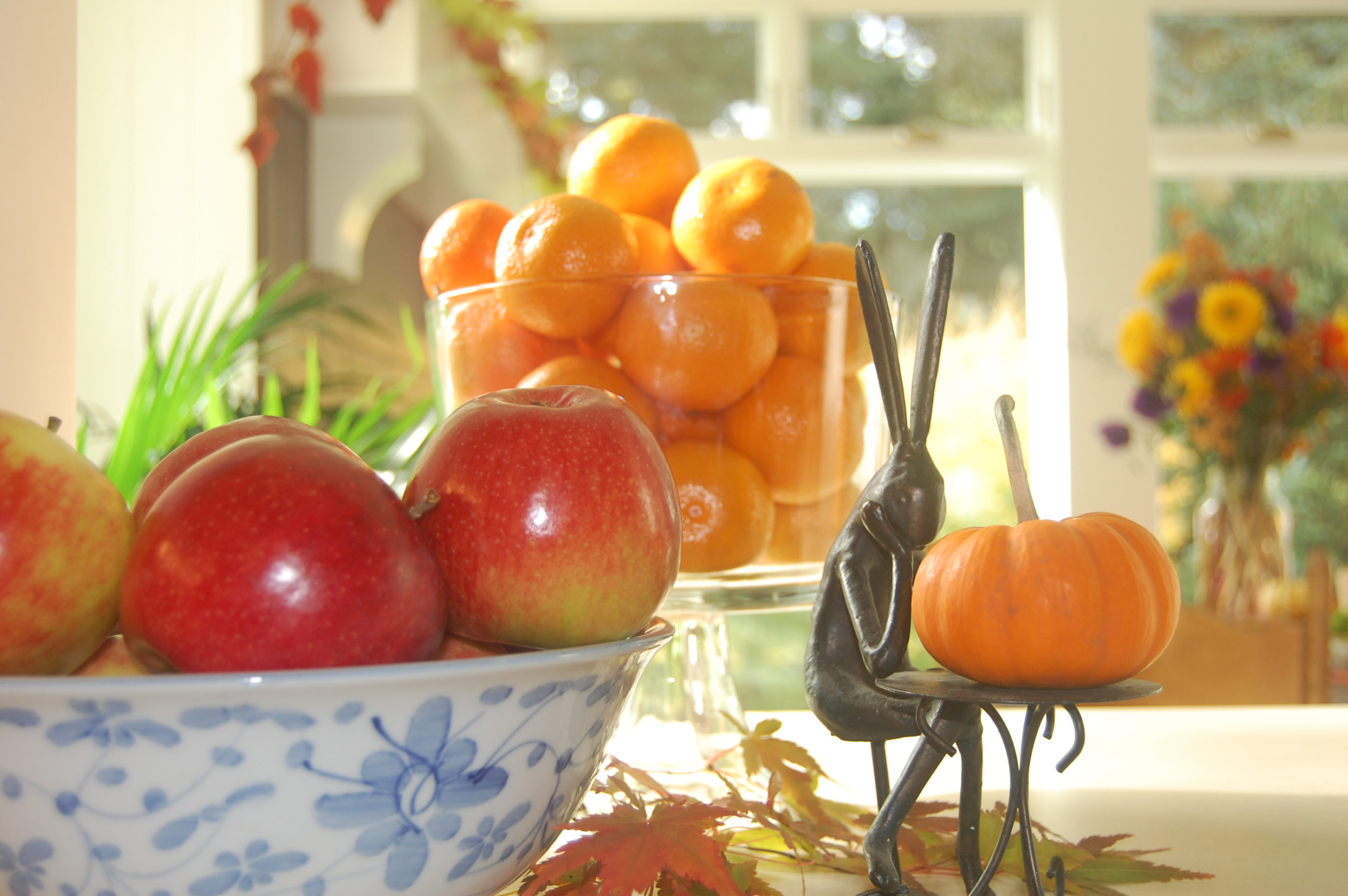 Fall Decorations With Pumpkins, Fruit and Wrought-Iron Bunny