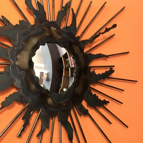 Textured Mirror on Orange Wall