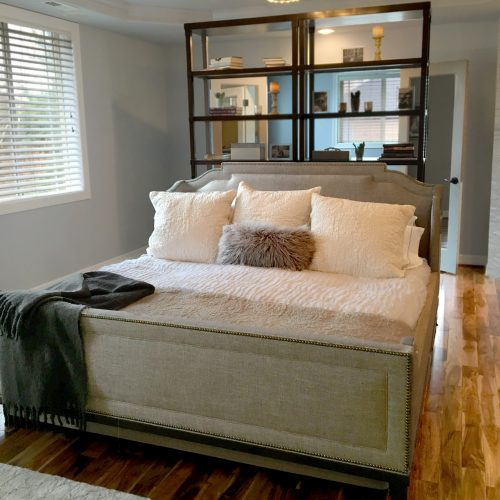 Master bedroom remodel with upholstered gray bed frame
